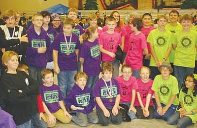 Courtesy<br> The four teams gathered for a group shot but had trouble getting everyone coordinated. From left: the WareWolves, the Virtual Volts, the Robo Wranglers and the Cyber Coyotes.