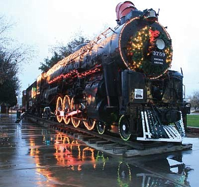 JC AMBERLYN/Miner<br> Rain added an extra dimension Thursday evening as it reflected Engine 3759 in Locomotive Park downtown.