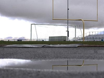 RODNEY HAAS/Miner<br> The stadium at Kingman High Schools sits quiet and soaked after this weekend's winter storm. The storm caused the boys soccer game with Prescott on Thursday to be postponed until Tuesday while Thursday and Friday's basketball games with Prescott and Flagstaff were also postponed when the weather made travel risky.