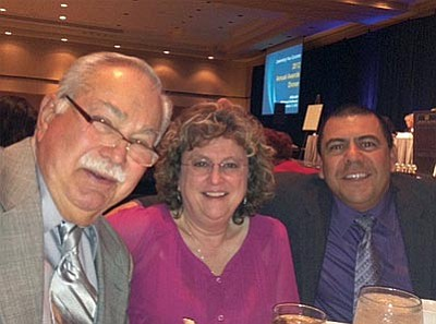 Courtesy<br> Charles Lucero, right, attends the recent annual ASBA conference – where he was honored for his service – with new school board members Bruce Ricca and Debbie Francis.