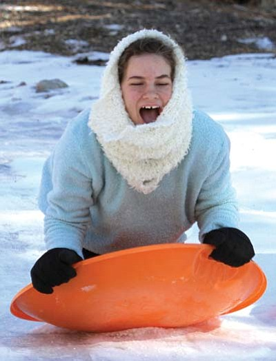 JC AMBERLYN/Miner<br> Abbigail Valora, 14, enjoys sledding down a hillside.
