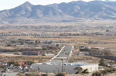 JC AMBERLYN/Miner<br /><br /><!-- 1upcrlf2 -->Traffic moves up and down Hualapai Mountain Road Thursday. The intersection of Stockton Hill Road and Hualapai Mountain Road is at the bottom of the picture, taken from a nearby hill.<br /><br /><!-- 1upcrlf2 -->