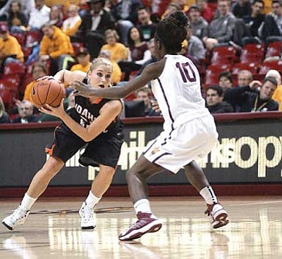 RODNEY HAAS/Miner <br /><br /><!-- 1upcrlf2 -->Kingman High graduate Lindsey Reed returned to Arizona Sunday as her Idaho State team finished their non-conference schedule with a 60-53 loss to Arizona State at Wells Fargo Arena in Tempe. Reed, a 2010 graduate, wanted to attend ASU, but took the Bengals' scholarship offer when the Sun Devils asked her to walk on. Reed, a junior, has started all but one of her games with Idaho State.<br /><br /><!-- 1upcrlf2 -->