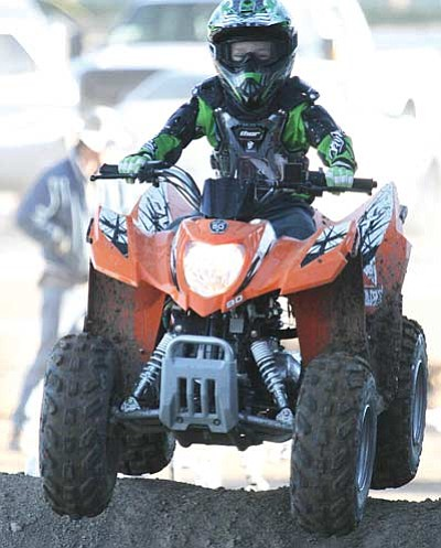 JC AMBERLYN/Miner<br> Dereck Smith, 5, races during the Peewee Quad event. His quad broke an axle earlier and it looked like he was out of the races for good. However, Desert Thunder Motorsports, which was displaying Arctic Cat ATVs at the show, offered to let Dereck ride one of their vehicles. Here, he rides on the borrowed Arctic Cat.