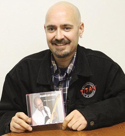 "JC AMBERLYN/Miner<br> Joe Buck holds a copy of his recently released debut CD: ""Jammin Joe Buck, The Amazing 1 Man Groove Machine."""