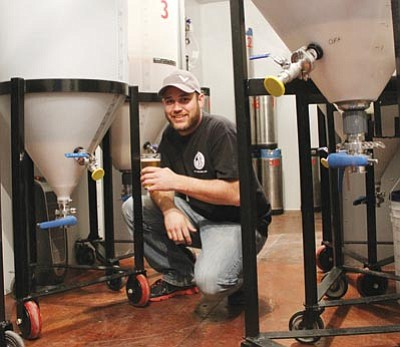 JC AMBERLYN/Miner<br>  Tim Schritter is pictured in his fermentation room Friday. He hopes to be brewing and selling downtown by May.