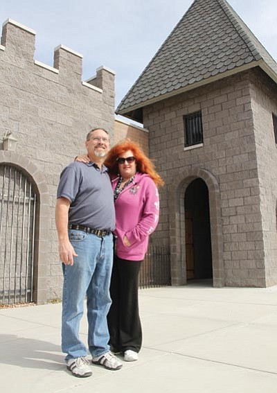 "Bob and Sandee Peet stand outside the ""castle"" building on Kino Avenue that will be the new home of Kingdom of God. - JC AMBERLYN/ Miner<br /><br /><!-- 1upcrlf2 -->"