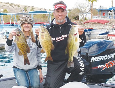 Kingman residents Tina Kennedy and Shane Moline took top honors with this bag of largemouth and smallmouth bass at a recent tournament at Lake Mohave. After weighing them in, the big fish were released back into the lake. - COURTESY