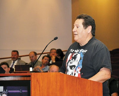 John Longoria speaks in favor of keeping the security checkpoint at the entrance to the Mohave County Administration Building during Monday's Board of Supervisors meeting.