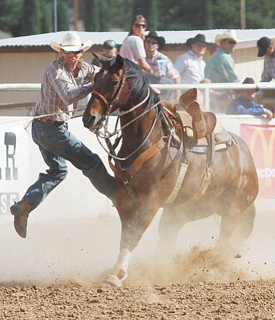 Bryce Barnes from Las Vegas, Nev., competes in the tie-down toping event last September during the 28th Annual Andy Devine Days Rodeo at the Mohave County Fairgrounds.<BR>JC AMBERLYN/Miner
