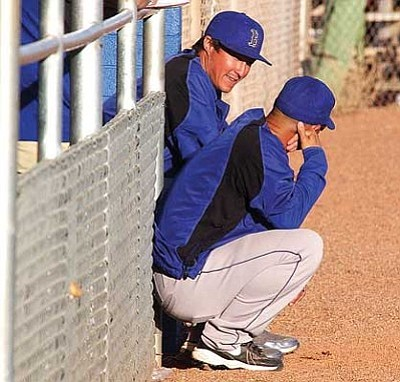 Kingman High baseball coach Chad Baitinger discusses strategy with assistant coach Chris Chavez during the Bulldogs' 13-0 loss to Phoenix Sandra Day O'Connor Wednesday.<br /><br /><!-- 1upcrlf2 --><br /><br /><!-- 1upcrlf2 --><br /><br /><!-- 1upcrlf2 -->RODNEY HAAS/Miner