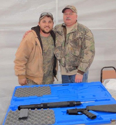 Matt Howell, left, and his father, Thom, with the Rock River Arms AR-15 they won at the Antelope Eaters hunt.<BR>Special to the Miner