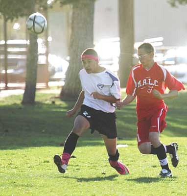 JC AMBERLYN/Miner<br /><br /><!-- 1upcrlf2 -->Kingman Academy's Cody Nazar looks to advance the ball during the Tigers' 6-0 win over MALC Tuesday afternoon. With KAHS moving to the AIA from the CAA, the school decided to drop the soccer program for the time being with hopes of bringing it back in two years.