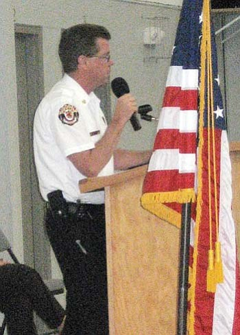 Golden Valley Fire District Chief Tom O'Donohue speaks to a town hall meeting last week.
