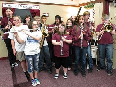 KIM STEELE/Miner<br /><br /><!-- 1upcrlf2 -->Thirteen band representatives from Kingman Middle School will be participating in the Northern Arizona Honor Festival of Performance for middle/junior high school musicians. They are, from left: front row, Faith Proferes (flute), Megan Evans (clarinet) and Madison Arave (clarinet); middle row, Matt Grimes (percussion), Chase Bell (baritone saxophone), Emma Blake (flute), Chris O'Neal (alto saxophone) and Colton Bell (trombone); and back row, Rebekah Heins (clarinet), Jacob Mucklow (bass clarinet), Carlos Rodriguez (clarinet), Alisha Valdez (clarinet) and Cammie Grimes (bassoon).