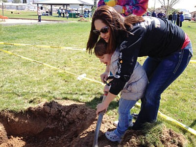 Amber Rucker and daughter Cacilia Fortier, 3, on Arbor Day at Cecil Davis Park.<BR>Courtesy