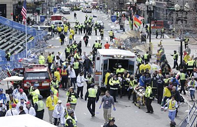 Medical workers aid injured people at the finish line of the 2013 Boston<br /><br /><!-- 1upcrlf2 -->Marathon following an explosion in Boston, Monday, April 15, 2013. (AP)