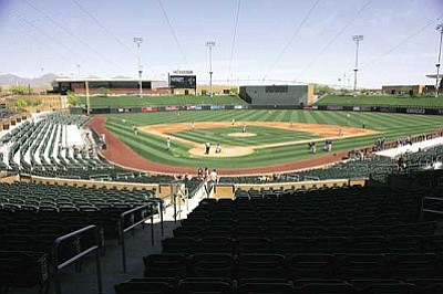 RODNEY HAAS/Miner<br /><br /><!-- 1upcrlf2 -->Even though the stands were mostly empty, the atmosphere was big-time for the Kingman Academy Tigers when they took the field Saturday at Salt River Fields, the spring training home of the Arizona Diamondbacks.
