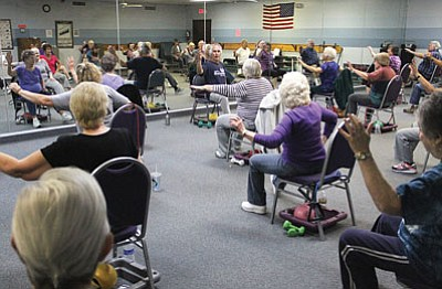 Local seniors work out to the beat at the 11 a.m. Silver Sneakers class at Kingman Fitness and Racquet club Friday.<BR>JC AMBERLYN/Miner
