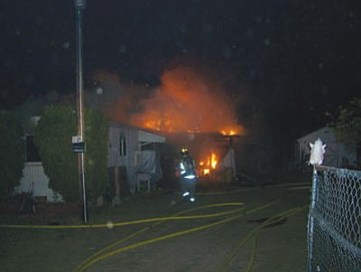 Officials with the Northern Arizona Consolidated Fire District said the fire that destroyed this home on Bluebird Lane Sunday night is suspicious in nature.<BR>Courtesy