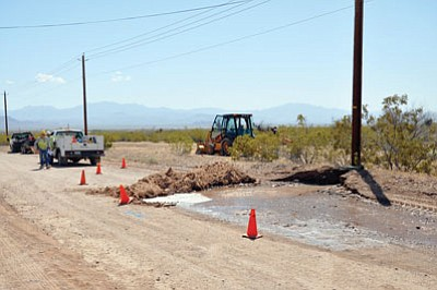 Water flows from a line broken by a backhoe Friday in Golden Valley.<BR>BUTCH MERIWETHER/Courtesy