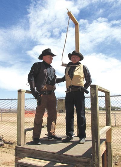 "J.T. Chance prepares to ""hang"" Cole Thornton from the gallows as part of a show by the Arizona Wild West Gunfighters.<BR>KIM STEELE/Miner"