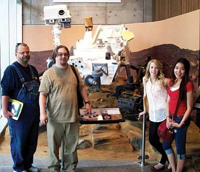 MCC/Courtesy<br /><br /><!-- 1upcrlf2 -->Mohave Community College engineering students, from left, John MayBee, James Faucher, Cassie Jones and Nancy Fujikado stand in front of the Curiosity Mars rover on display at Arizona State University in Tempe. The students toured the university's engineering transfer program. They all attend MCC's Kingman campus.