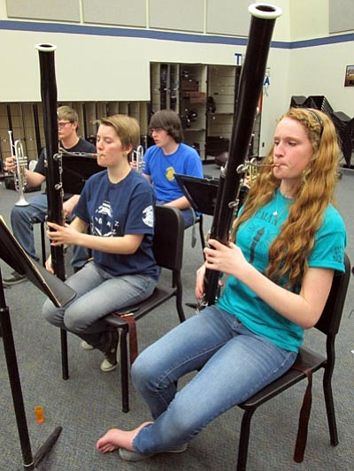 Bassoon players, from left, Lily Rhoades and Cherry Niel play their bassoons during a Kingman High School wind ensemble practice session. Behind them, Nick Altman and Chandler Zimmerman wait to join in.<BR>KIM STEELE/Miner