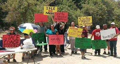Members of the Hualapai tribe protest neighboring businessman Nigel Turner on Diamond Bar Road, where Turner on Saturday began charging a toll to motorists on their way to Grand Canyon West and the world-famous Skywalk tourist attraction.<BR>Courtesy