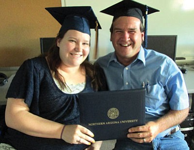 Honey Bahre and dad Ron Bahre earned diplomas this spring from Northern Arizona University.<BR>KIM STEELE/Miner