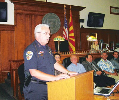Kingman Police Chief Robert DeVries, one of the key players in founding drug court in the city, addresses graduates and their families Thursday. <BR>DOUG McMURDO/Miner
