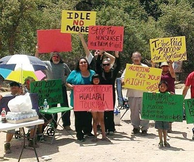 Courtesy<br /><br /><!-- 1upcrlf2 -->Members of the Hualapai tribe protest neighboring businessman Nigel Turner on Diamond Bar Road, where Turner began charging a toll to motorists on their way to Grand Canyon West and the world-famous Skywalk tourist attraction.<br /><br /><!-- 1upcrlf2 --><br /><br /><!-- 1upcrlf2 -->
