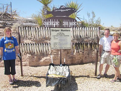 DON MARTIN/Special to the Miner<br /><br /><!-- 1upcrlf2 -->The fishing season on Lake Mead started slowly for some, but the Anderson family landed plenty of fish – 128 in all – on their excursion. Pictured from left are Allison, Scott and Jen Anderson.