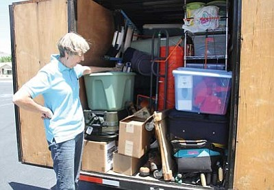 Team leader Judy Lewis looks inside the trailer, which is full of tools and equipment. The goal is to be self-sufficient when working in an area where resources may be scarce.