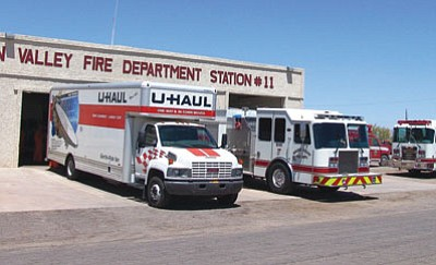 """A U-Haul is used to move from the Golden Valley Fire Department's old Station 11 on Mayer Road to the new station at 3480 Bacobi Road. """"The new fire station location better serves the community,"""" said Fire Chief Thomas O'Donohue. The Bacobi Road station is one of three in the Golden Valley Fire District that are within five miles of many homes, enabling those residents to qualify for lower fire insurance rates. The district's Public Safety Training Center on Colorado Road will fill a void for even more residents to qualify for lower rates as the district continues to improve its response times. The new Station 11 was built at a cost of $830, 000. The 12,000 square-foot facility includes six bedrooms, a large kitchen, exercise room, large dayroom that can double for training and meetings, and space for up to eight fire apparatus. The old station will be used for administration.<BR>Courtesy"""