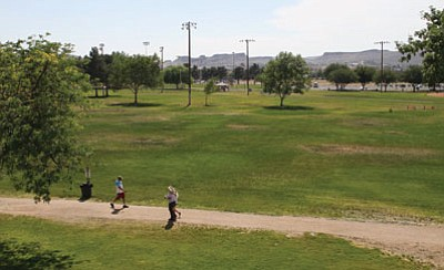 People enjoy Centennial Park recently – on a day that wasn't as hot as what it will be over the weekend. While hot temperatures come to Arizona every summer, officials are urging people to be extra-cautious this weekend, when daytime highs will exceed 110 degrees.<BR>JC AMBERLYN/Miner
