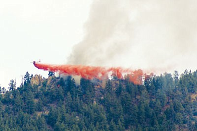 Fire retardant is dumped Saturday on the Dean Peak Fire located between Blake Ranch Road and DW Ranch Road about 10 miles southeast of Kingman.<BR>HERBERTA SCHROEDER/Courtesy