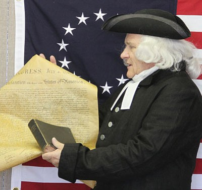 Grif Vautier, dressed as historical figure Jonathan Witherspoon, displays the Declaration of Indpendence at Kingman Presbyterian Church. Witherspoon was the only clergyman who signed the document in 1776. Vautier will give two presentations in Kingman during July.<BR>JC AMBERLYN/Miner