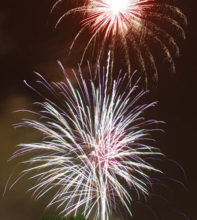 Last year's fireworks at the Mohave County Fairgrounds were entertaining. This year the Kingman Boomers, which raises money for the show, gathered almost $25,000 in donations to put on this year's extravaganza. The show is in the center of town, which makes for great viewing parties for those who don't want to linger in the fairgrounds. That's the thinking over at the Kingman Presbyterian Church, 2425 Detroit Ave., which is hosting a social event starting at 7 p.m. and ending with a fireworks watching party.  <BR>JC AMBERLYN/Miner