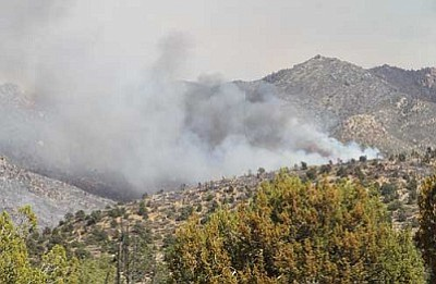 Dean Peak Fire Photographed from DW Ranch Road in the Hualapai Mountain foothills. (JC Amberlyn/Miner)