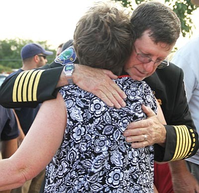 Mike and Debbie Casson hug after the ceremony.<BR>JC AMBERLYN/Miner