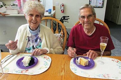 KIM STEELE/Miner<br /><br /><!-- 1upcrlf2 -->Frances and J.W. Stone enjoy pieces of cake during their 70th anniversary celebration at Helen's Place Assisted Living in Kingman. The couple was joined by friends and family as they reminisced about their life together.