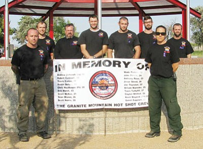 Courtesy<BR>Shown are the eight members of the BLM Colorado River District Ground Crew before releasing 19 balloons that symbolized the 19 members if the Granite Mountain Hot Shot Team killed on June 30 fighting the Yarnell Fire near Prescott. The Colorado River District Crew was the first on the ground in the Dean Peak Fire near Kingman.