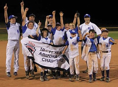 JC AMBERLYN/Miner <br /><br /><!-- 1upcrlf2 -->John Bathauer (back left) poses with his Kingman North 10-11 All Star team after winning the District 9 championship in July 2011. Bathauer lost his battle with cancer in March 2012. Saturday his family will gather for the 2nd Annual John Bathauer Memorial Softball Tournament at Centennial Park. <br /><br /><!-- 1upcrlf2 -->