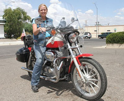 Christine Allen of Golden Valley will lead the Women's Freedom Ride from Flagstaff to Las Vegas. The group of about 30 women bikers will be traveling from Charleston, S.C., to San Diego to raise money for veterans injured while serving their country. Allen is president of Women in the Wind Cactus Cuties, a local women's motorcycle group with about 15 members. (JC AMBERLYN/Miner)<br /><br /><!-- 1upcrlf2 --><br /><br /><!-- 1upcrlf2 -->