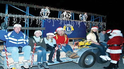 Lions Club members at the Very Merry Parade of Lights last year. (Courtesy)
