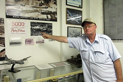 KIM STEELE/Miner<BR> Rob Chilcoat, curator of the Kingman Army Airfield Museum, points out a photo of the 5,000th Flying Fortress Boeing airplane built after Pearl Harbor. It was sent to Kingman to be salvaged.
