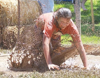 JC AMBERLYN/Miner<BR> Vanessa Blanco falls into the mud during the race last year. Mighty Mud Mania returns at 10 a.m. Thursday.