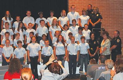 DOUG McMURDO/Miner<BR> Thirty local youth graduated from the Kingman Police Department's Junior Academy on Thursday, the second session of the summer. More than 400 have graduated since Police Chief Robert DeVries established the program seven years ago.