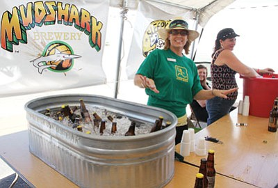 From left to right, Danielle Sorace of the MCFA Board of Directors, Mary Brock and Renee Carlson were helping provide beer samples during Saturday's beer festival. Mudshark Brewery is from Lake Havasu City. (JC AMBERLYN/Miner)